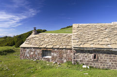 Stone cottage. In an idyllic landscape on a sunny day Royalty Free Stock Photos
