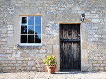 Stone Cottage. Front Door and Exterior of a Beautiful Stone Cottage Royalty Free Stock Photography