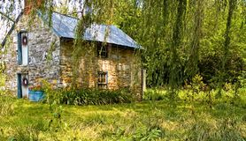 Stone Cottage - 2. Small stone bungalow or cottage along the side of a creek in Maryland royalty free stock images