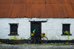 Stone cottage and bicycle Stock Photography