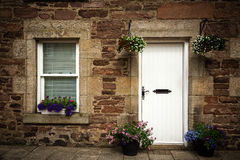 Stone cottage door and window detail. Royalty Free Stock Images
