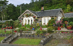 Stone cottage with flower garden Stock Photos