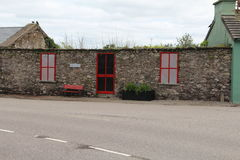 Stone cottage in Ireland without a roof. But with red frames for door and windows Stock Image