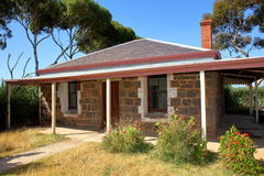 Stone cottage. Old Australian stone cottage, probably originally built in the late 1800s. Note the slate tile roof. Photo taken at Werribee Open Range Zoo Stock Image
