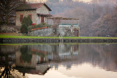 Stone cottage on Sirio lake, brown colors, peaceful atmosphere