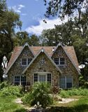 Stone Cottage. This is a Summer picture of a stone cottage located in Bushnell, Florida in Sumter County.  This two story stone cottage feature Gables and was Royalty Free Stock Photos