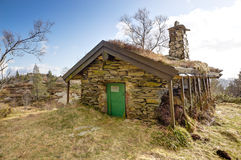 Stone cottage up in a mountain Stock Image
