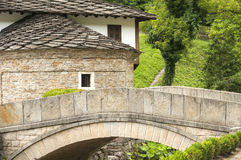 Stone countryhouse and stone bridge Stock Images