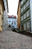 Old cobbled narrow street with colorful houses. royalty free stock photos