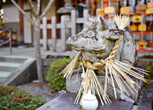 Stone cow Statue in Japanese temple Stock Photo
