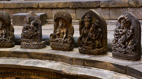 Stone crafted gods in Lalitpur Nepal. Stone crafted gods surrounding the sacred temple in lalitpur Nepal Royalty Free Stock Photo