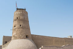 Stone cream colour ancient arabian fort with tower and high walls Stock Photo