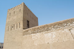 Stone cream colour ancient arabic castle with tower and high walls. In the UAE Stock Images