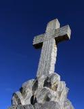 Stone cross. Big stone cross blue sky Royalty Free Stock Photos