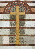Stone cross. Medieval cross in stone and bricks, with beautiful carvings (photo taken in Bologna, Italy stock photo