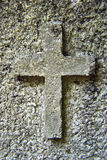 Stone cross. Close-up photograph of stone cross on a wall Stock Photo