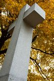 Stone cross. With tree in fall color Stock Photo