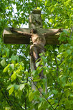 Stone cross. Cross surround by green leaves Stock Photo