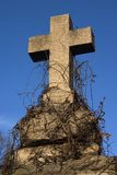 Stone cross. An old gravestone cross against blue sky Royalty Free Stock Photo