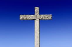 Stone Cross. Religious stone cross on a beautiful blue sky Royalty Free Stock Image