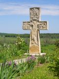 The stone cross. The stone cross stays on the hill near a river Royalty Free Stock Images