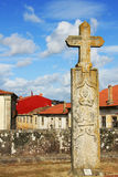 Stone Cross. Landmark over roofs in a blue sky Stock Photo