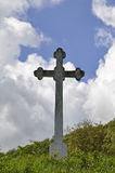 Stone cross against in the blue sky. Stone cross against in the blue  sky Royalty Free Stock Photo