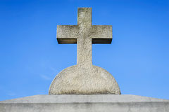 Stone cross. Against blue sky in a cemetery stock image