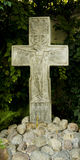 Stone cross. Bas-relief of crucifix. Religion Royalty Free Stock Image