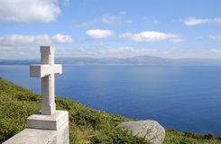 Stone cross in Cape Finisterre Stock Photo