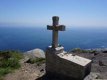 Stone cross at Cape Finisterre Royalty Free Stock Photo