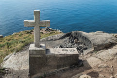 Stone cross in Cape Finisterre Royalty Free Stock Images