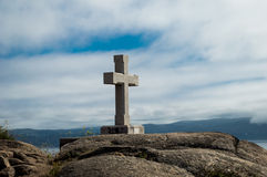 Stone cross in Cape Finisterre Stock Photos