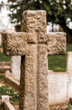 Stone cross in a cemetery Stock Photo