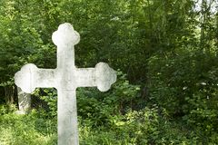 Stone cross in the cemetery Royalty Free Stock Image