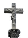 Stone cross with Christ crucified Stock Images