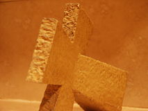 Stone cross close up. Close up of stone cross on tile background Royalty Free Stock Images