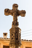 Stone cross. Close up of old stone  religious christian cross with a lot of ornaments Royalty Free Stock Images