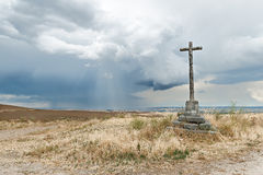 Stone cross. On dark sky background with Royalty Free Stock Photography