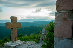 Stone cross.A fortress on a background of mountains, where he download the film Storm Gates. Gelendzhik district.Russia. Stock Photos