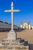 Stone Cross in front of the Church and Pilgrim lodgings of the Sanctuary of Nossa Senhora do Cabo. Espichel Cape, Sesimbra, Portugal Royalty Free Stock Photography