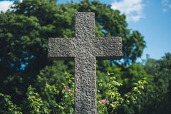 Stone cross on grave, gravestone on cemetery Stock Photos