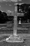 Stone cross gravestone Royalty Free Stock Image