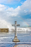 Stone cross in memory of deceased sailors Stock Image