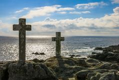 Stone cross monuments by the sea in late afternoon, Costa da Morte, Galicia. Royalty Free Stock Image
