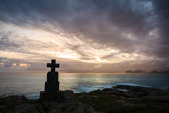 Stone cross monuments by the sea in the sunrise, Castro Urdiales, Cantabria Stock Photos