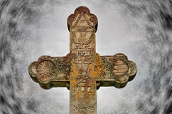 Old Orthodox Christian stone cross. Old orthodox christian cross with vignette effect royalty free stock photo