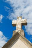 Stone cross on old church Stock Images
