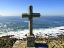 Stone Cross over Atlantic Sea Stock Photo