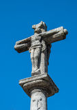 Stone cross over blue sky Stock Image
